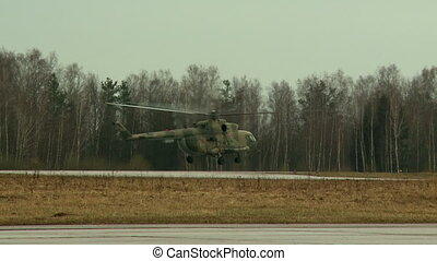 Military helicopter lands on airstrip - View of military...