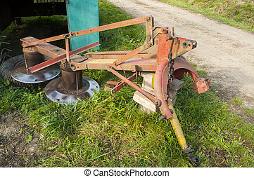 disk harrow - picture of a disk harrow in countryside