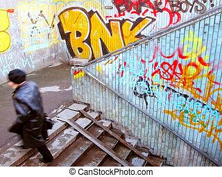 graffiti on a pedestrian underpass wall