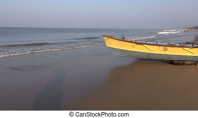 wooden boat on Kerala beach - colorful wooden boat on Kerala...