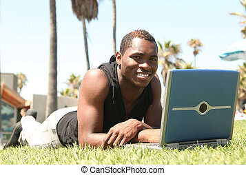 African Amercian Man Working on a Laptop