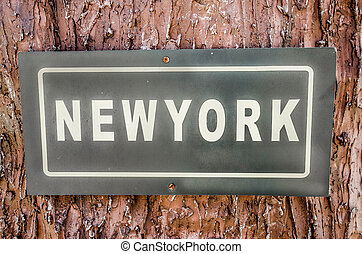 Sign of newyork text plate on tree background