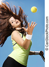 Woman playing tennis - A beautiful young woman playing...