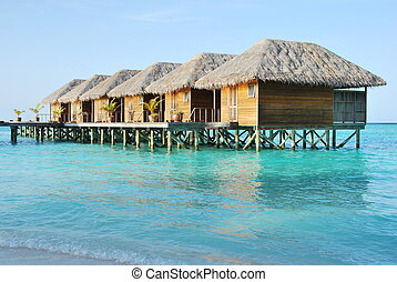 Water villas in Maldives - beautiful seascape with water...