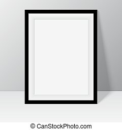 Black frame for paintings or photographs standing near the...