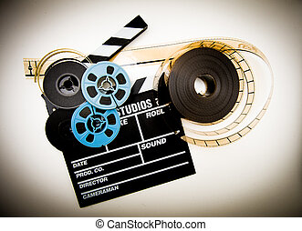 Clapper board and film reels vintage color effect - Clapper...