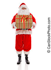 Father Christmas holding a gift wrapped present isolated