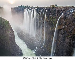 Victoria Falls sunset, Zambia side with zambezi river, red...