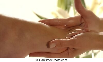 aromatic relaxing foot bath - close up of a foot massage