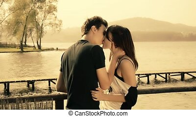 romantic young couple - Lovers near a lake in a windy day....