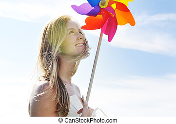 beautiful bride outdoor with colorful windmill toy - happy...