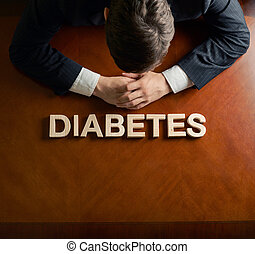 Word Diabetes and devastated man composition - Word Diabetes...