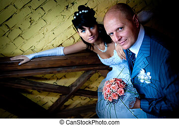Newlywed - Portrait of a newlywed couple with the brides...