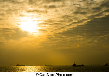 Nature background sunset time beach with boats