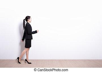 business woman walking - Successful business woman walking...