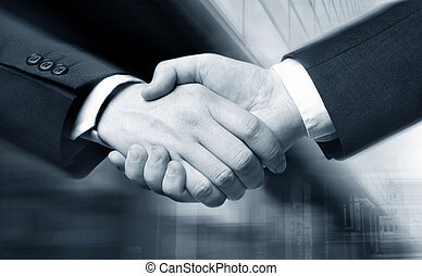 business hand shake and a office in background, Suit...