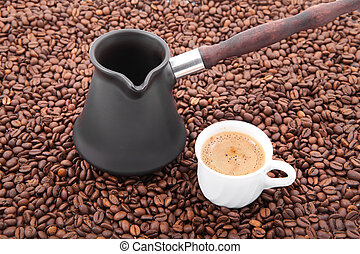 Coffee time - Cup of fresh coffee against coffee grains