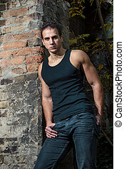 Muscular man outdoor portrait - A Muscular man outdoor...
