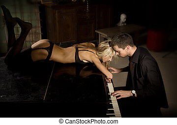 Love music - The musician plays the old piano nearby the...