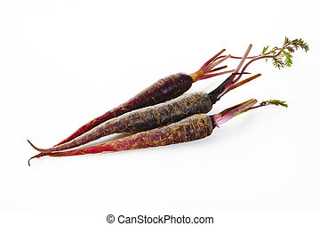 Purple carrots on white background