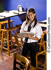 Cheerful young waitress - Young Hispanic waitress ready to...