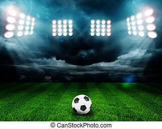 Soccer ball on the field of stadium with light