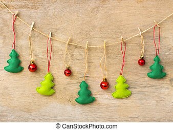 christmas tree hanging over wooden background