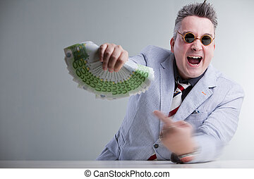man pointig banknotes in his hand - mad man in suitjacket...