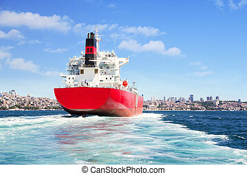 Cargo ship sailing in to the sea - Red cargo ship sailing in...