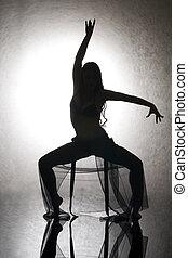 Dancing woman. - Silhouette of the beautiful woman dancing...