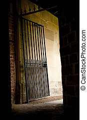 dark alley - iron gate exit from a dark mysterious alleyway