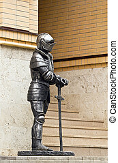 Knight in armor with a sword - The figure of a knight in...