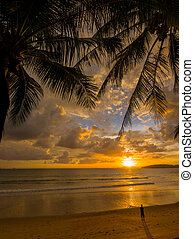 Tropical sunset on the beach Ao-Nang Krabi Thailand at...