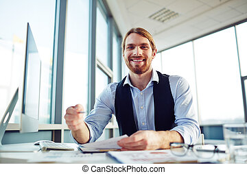 White collar worker - Cheerful office worker looking at...