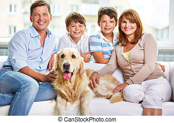 Having good time - Cheerful family of four and their cute...
