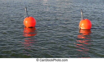 red boat yacht buoy on sea water in port