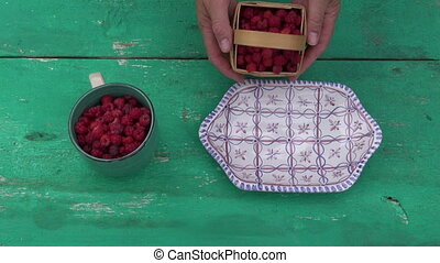 fresh sweet wild raspberry in plate - fresh sweet wild...