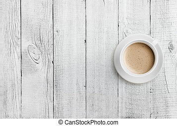 coffee cup top view on white wood table background