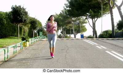 girl jogging on street doing sport - Beautiful girl jogging...