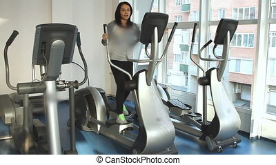 Beautifull female on an elliptical trainer - Beautifull...