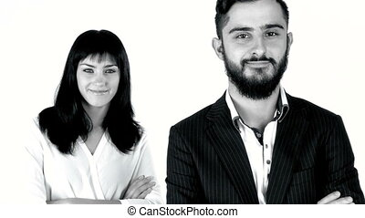 Smiling business couple bw - Black and white portrait of...