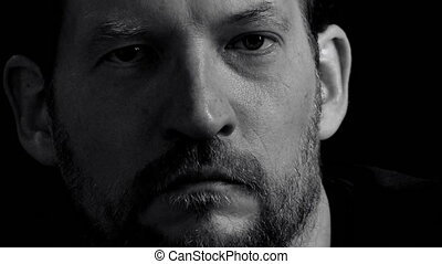 Portrait closeup of sad man - Black and white closeup of...