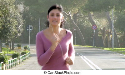 Gorgeous female model jogging