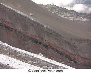 Red strata on the slopes of Cotopaxi Volcano - in the...