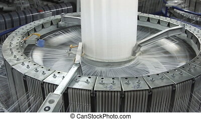 Textile industry - yarn spools on spinning machine in a...