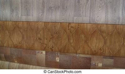 Rolls of linoleum in flooring warehouse pan shot
