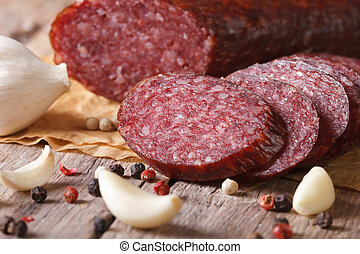 smoked sausage with spices and garlic on old table....