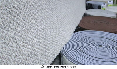 Rolls of carpets in retail flooring store
