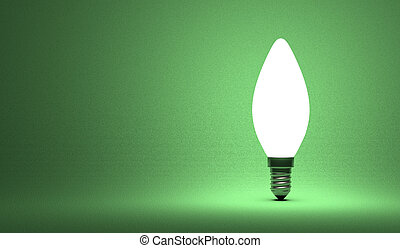 Shining torpedo light bulb on green background