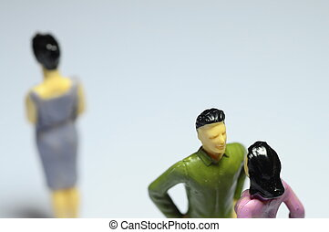 Man chatting with woman, and single woman - Miniature Man...